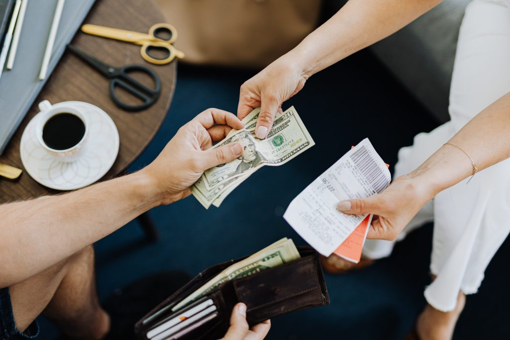 Hands exchanging cash for doing task/s